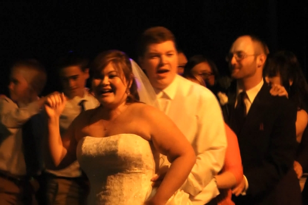 Conga line with bride and groom leading